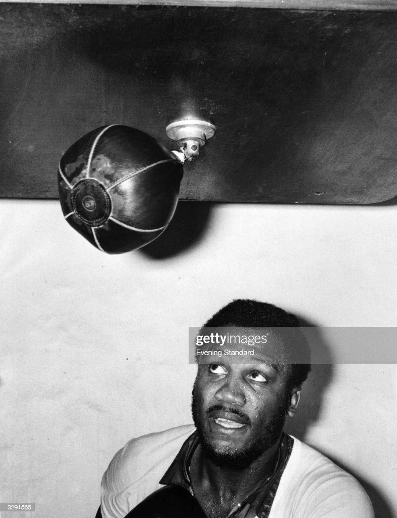 Boxer Joe Frazier hits the punching bag.