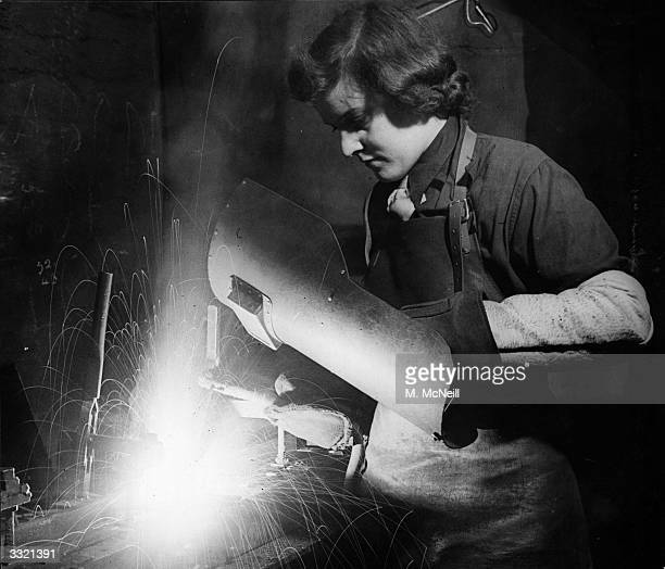 Peggy Hyland a woman war worker electric arc welding in one of Britain's largest shellproducing factories