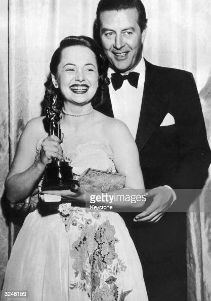 Olivia de Havilland receives her Best Actress Oscar from actor Ray Milland for her performance in 'To Each his Own' directed by Mitchell Leisen