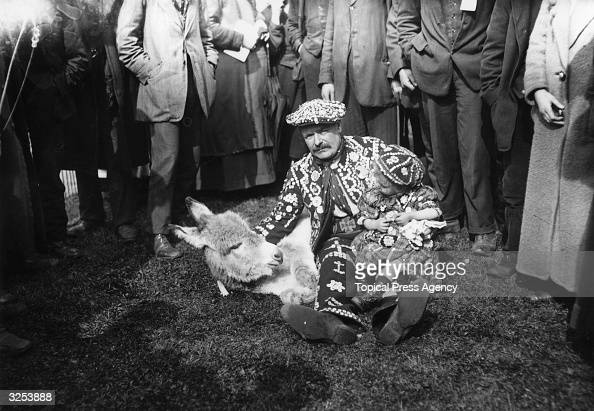 A Pearly King and his son with their playful young donkey at the Costeres Donkey Show