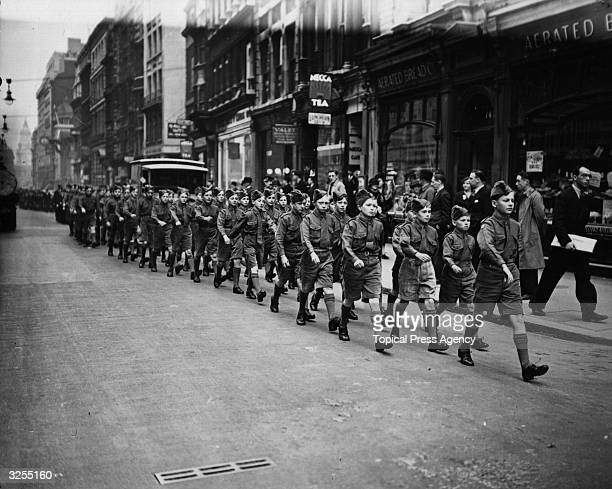 Boys from Saint Dunstan's College Catford led by the OTC and its band marching from Cannon Street to the church of Saint DunstanintheEast for the...