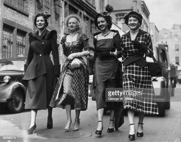 Four ladies dressed to the nines arrive at the London Coliseum for a presentation by the Apparel and Fashion Industry's Association held during...