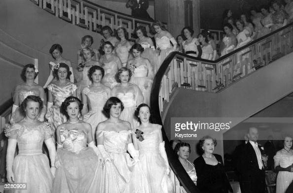 The massed ranks of debutantes at the Queen Charlotte's Ball at Grosvenor House descend into the ballroom