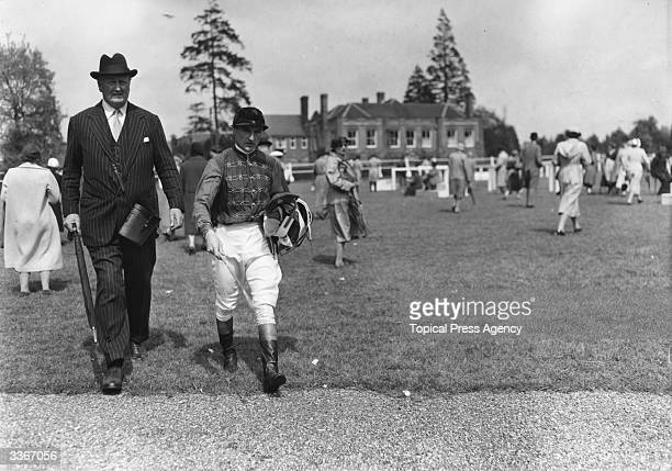 Captain Cecil BoydRochfort trainer of the Queen's horses with jockey Harry Carr in the royal colours at Lingfield Races