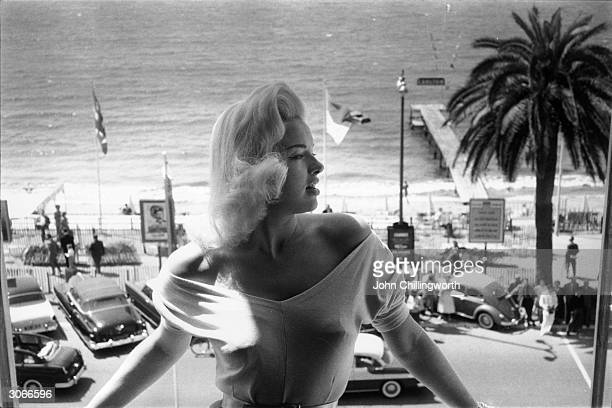 Blonde bombshell Diana Dors at Cannes' International Film Festival Original Publication Picture Post 8396 Diana Queen Of Cannes pub 1956