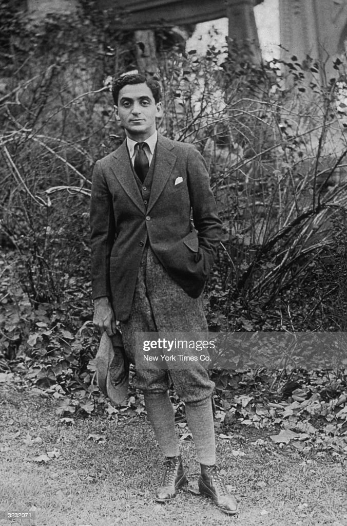 Full-length portrait of songwriter and lyricist <a gi-track='captionPersonalityLinkClicked' href=/galleries/search?phrase=Irving+Berlin&family=editorial&specificpeople=208654 ng-click='$event.stopPropagation()'>Irving Berlin</a> (1888 - 1989) wearing breeches and standing outdoors at French Lick Springs Hotel.