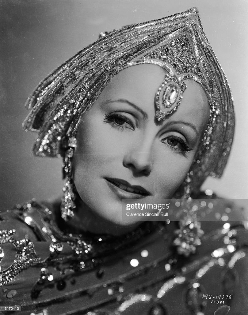 Wearing an ornate beaded headdress which completely hides her hair film star Greta Garbo plays the title role in the film 'Mata Hari' directed by...
