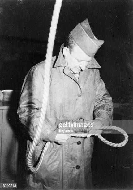 Master Sergeant John Wood of San Antonio Texas preparing a noose for a convicted Nazi war criminal Sergeant Wood is the official hangman at the war...