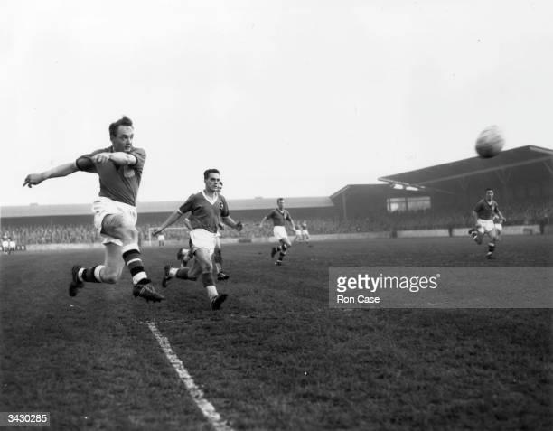 Plymouth Argyle footballer Gauldscoring a goal against Gillingham