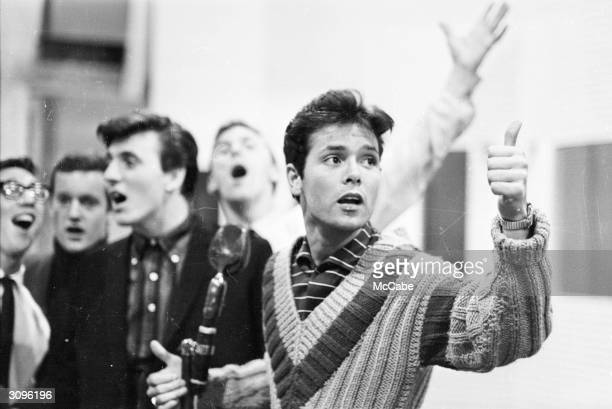Singer Cliff Richard with members of the Shadows his backing group Next to him is Bruce Welch rhythm guitar
