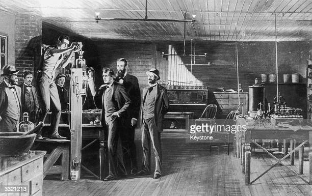 The birth of the incandescent lamp a scene in Edison's Menlo Park laboratory New Jersey USA Francis Jahl is replenshing the supply of mercury in the...