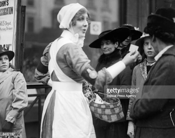 Lady Diana Manners dressed in a nurse's uniform to collect funds for 'Our Day' which aims to help soldiers at the front during World War I