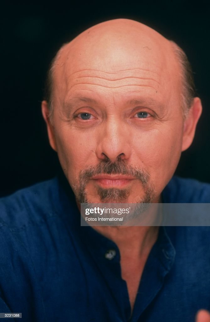 Headshot of American actor Hector Elizondo in front of a dark backdrop, Fox Studios, California.