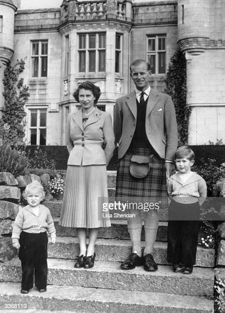 Queen Elizabeth II and The Prince Philip Duke of Edinburgh with their two young children Princess Anne and Prince Charles outside Balmoral Castle The...