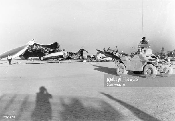 Jordanian troops at Dawsons Field Jordan guard the remains of American and Swiss airliners burntout by hijackers