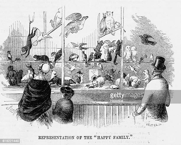 A 19thcentury family at the 'Happy Family' exhibit at PT Barnum's American Museum The exhibit grouped several different animal species in a single...