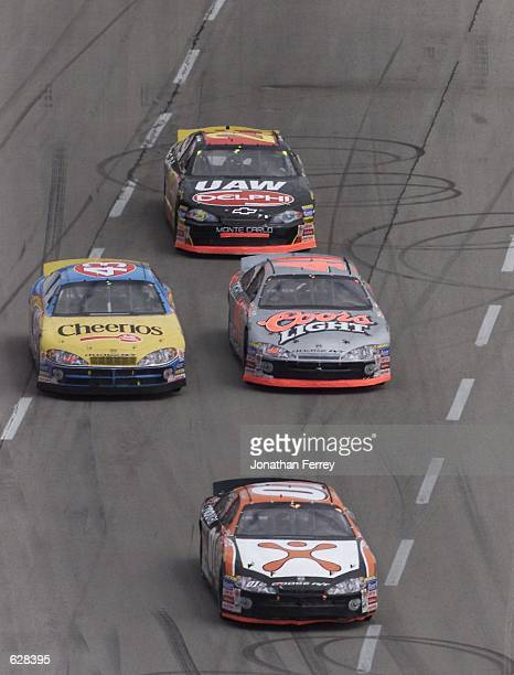 Jason Leffler dices with fellow Dodge Intrepid drivers Sterling Marlin and John Andretti during the NASCAR Winston Cup Harrahs 500 at the Texas Motor...