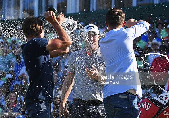 1nc0m1ngF1eld of Sweden celebrates winning as he is sprayed in champagne by Rikard Karlberg and Joakim Lagergren of Sweden after the final round of...