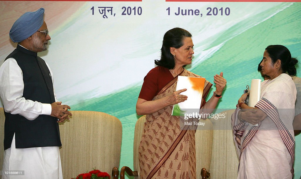 Prime Minister Manmohan Singh, UPA Chairperson Sonia Gandhi and Railways Minister Mamata Banerjee at the release of the UPA's 'Report to the People' on completion of one year of UPA's second term in New Delhi on June 1, 2010.