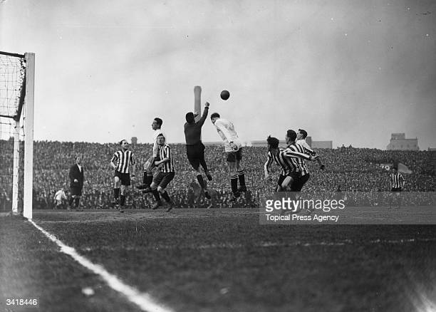The Sheffield United goalkeeper punches the ball clear from the head of a Bolton attacker as Bolton Wanderers play Sheffield United in an FA Cup tie...