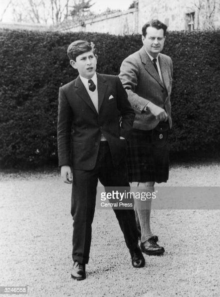 Prince Charles arrives at Gordonstoun School in Scotland for his first term and is shown around by Captain Iain Tennant chairman of the board of...