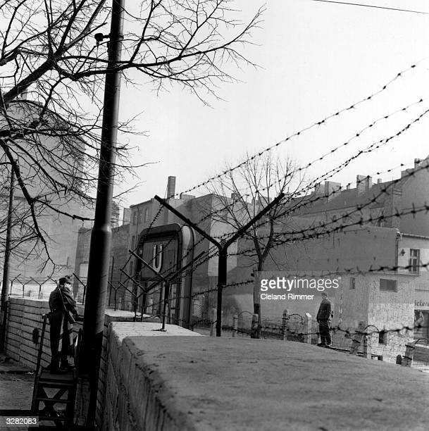 The Berlin Wall viewed from the western side with border guards face to face