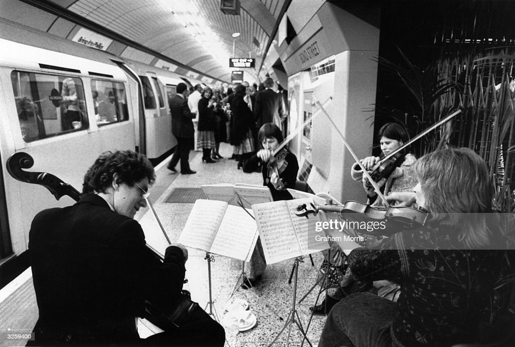 A string quartet play on the Jubilee Line at Bond Street station London