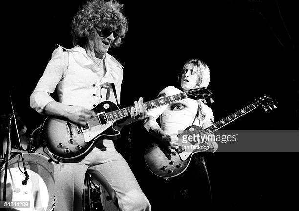 Guitarists Ian Hunter and Mick Ronson perform live on stage with The Hunter Ronson Band at Colston Hall in Bristol England on 1st April 1975