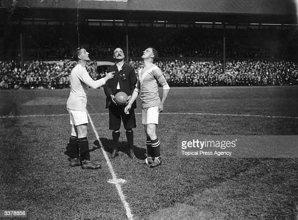 Captains toss the coin before the start of the match between Birmingham City and Chelsea