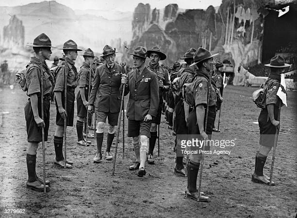 Edward Prince of Wales with founder of the boy scouts Robert BadenPowell inspecting a troop of scouts at the Boy Scouts Jamboree at Wembley