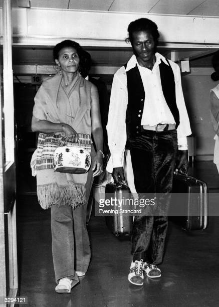 Rock 'n' roll legend singer songwriter and guitarist Chuck Berry arrives at Heathrow Airport with his wife Thematta