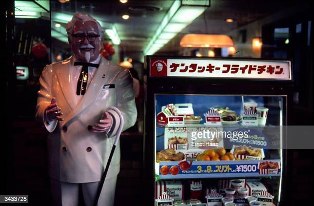 A Kentucky Fried Chicken stall with an effigy of Colonel Sanders the founder of the company