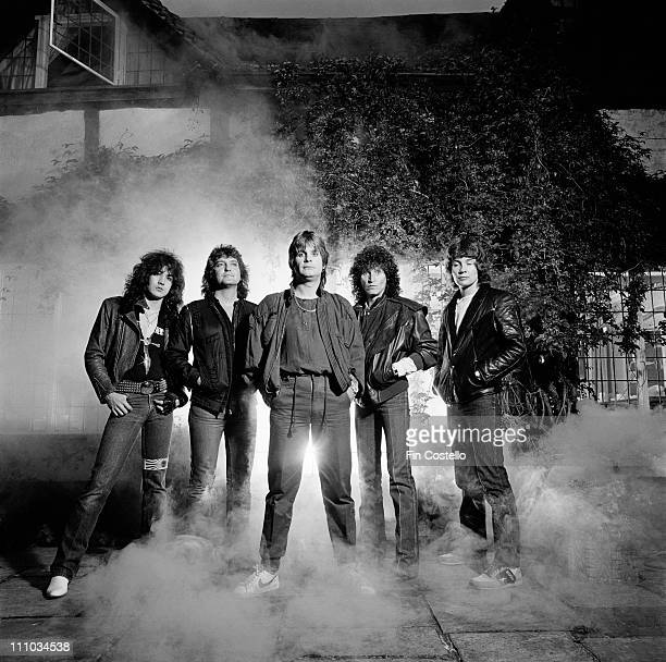 1st AUGUST Ozzy Osbourne and his band pose together in front of Ridge Farm Studios in West Sussex England during the recording of the album 'Bark At...