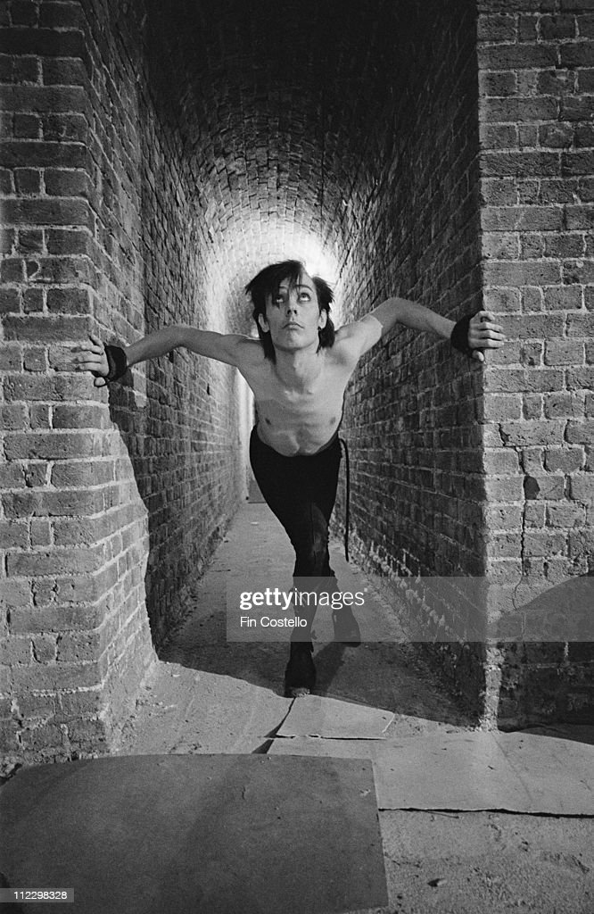 Peter Murphy from English band Bauhaus posed at the Roundhouse in Camden London during the filming of the Ziggy Stardust video in August 1982