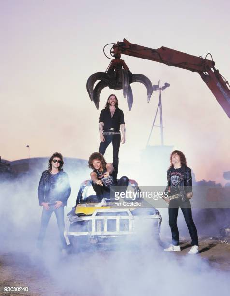 Posed group portrait of Motorhead in a Pimlico scrapyard with Lemmy in 1984 Left to Right Phil Campbell Pete Gill Lemmy Kilmister Mick 'Wurzel'...