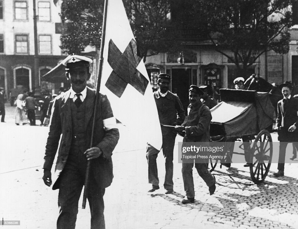 The Red Cross taking away the wounded during the Lisbon Revolution of 1910, which commenced on the 3rd October. Manoel II (1889 - 1932) the King of Portugal, was deposed in favour of Theophilo Braga (1843 - 1924) who became President for two years.