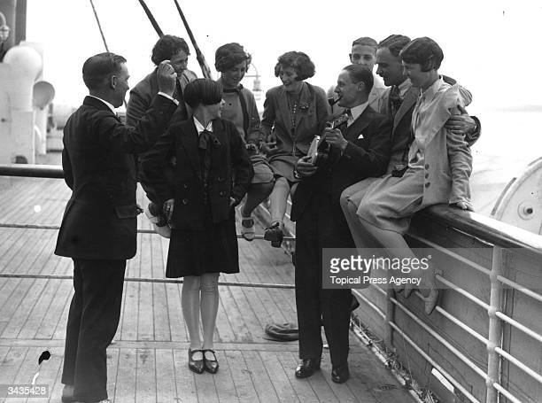 A group of young passengers gathered around a banjo player on the deck of the Canadian Pacific liner Duchess of Bedford during a transatlantic voyage