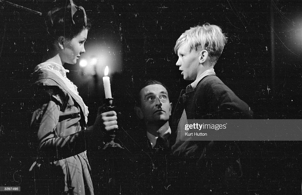 13-year-old schoolboy Anthony Wager plays the young Pip, and Jean Simmons, the young Estella in the Cineguild film adaptation of Dickens' novel 'Great Expectations'. Director David Lean (1908-1991) gives the young actors a screen test at Denham Studios. Picture Post - 9631 - A Boy With Great Expectations - pub. 1945
