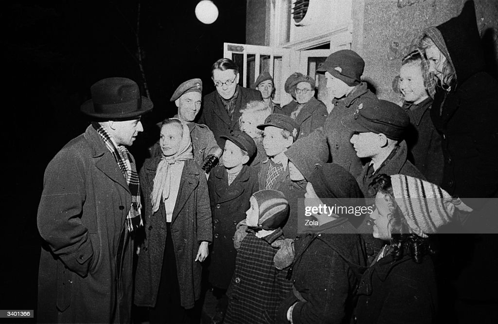 John Hynd (left), British minister for the civil administration of the British zone in Germany supervises the evacuation of 25,000 children from Berlin to the country. Original Publication: Picture Post - 3040 - Wanted: A Policy For Germany - pub. 1945