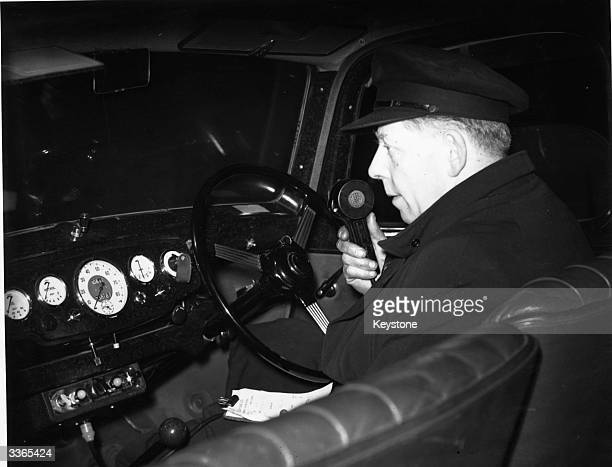 Driver Simpson calls his office from a street in London during tests for the city's first radiotaxi system allowing twoway communication between...
