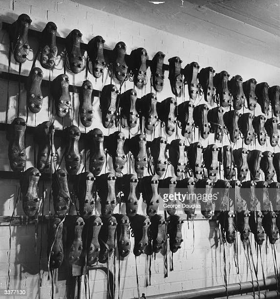 Arsenal FC boot room at Highbury Original Publication Picture Post 5596 'A' Is For Arsenal pub 1951