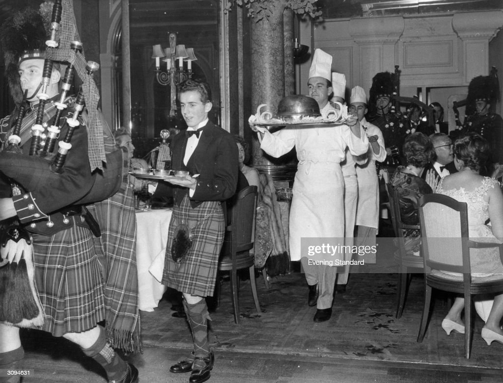 Piping in the haggis in the restaurant at the Savoy Hotel, London.The haggis born by a chef is preceded by a piper and the whisky. It is usually eaten on Burns night (25th January).