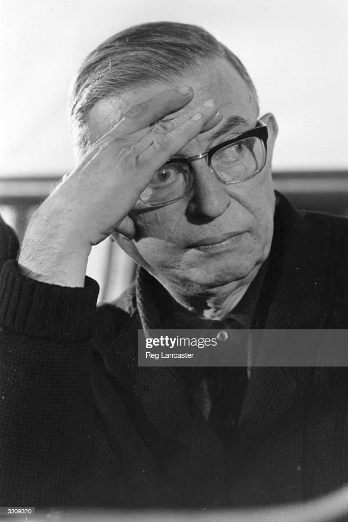 French writer and existentialist philosopher Jean-Paul Sartre pauses for thought during a speech in Paris on Vietnam War crimes.