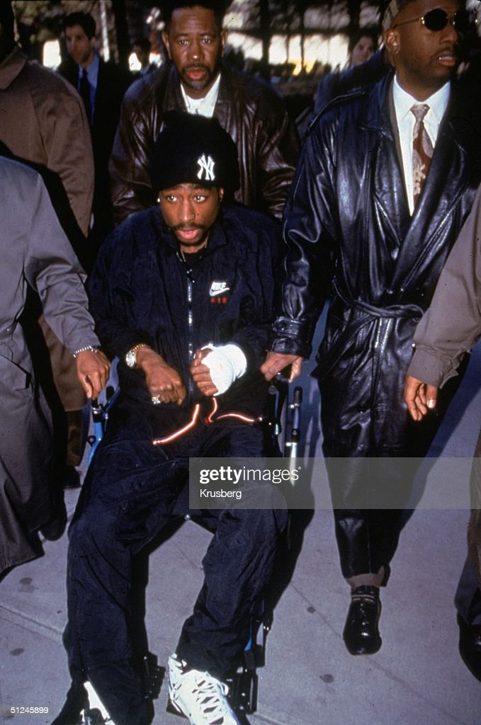 1st December 1994, American rapper and actor <a gi-track='captionPersonalityLinkClicked' href=/galleries/search?phrase=Tupac+Shakur&family=editorial&specificpeople=563476 ng-click='$event.stopPropagation()'>Tupac Shakur</a> (1971 - 1996) is helped out of court in a wheechair the day after his shooting.