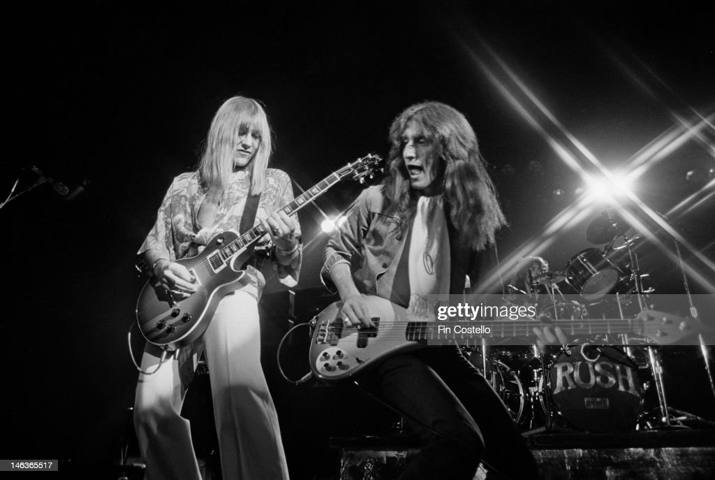Alex Lifeson and Geddy Lee from Canadian group Rush perform live on stage in Springfield Massachusetts 9th December 1976 during their All The World's...
