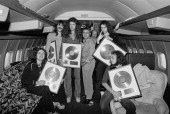 Members of the rock group Deep Purple posed with gold discs on board the Starship aeroplane during the band's tour of the United States in December...