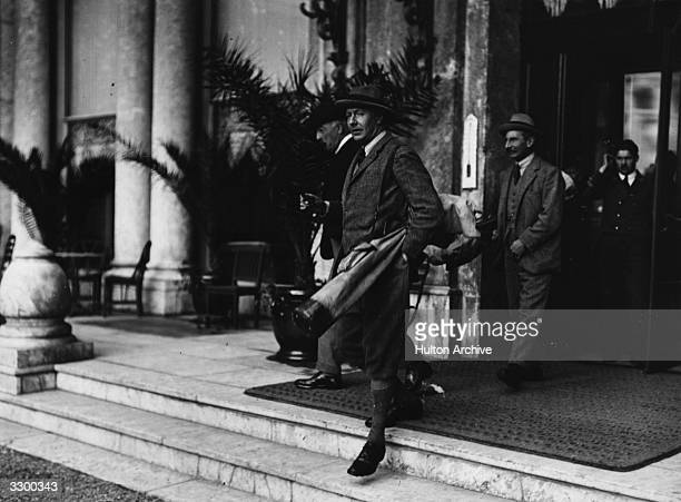 The 2nd Duke of Westminster Hugh Richard Arthur Grosvenor leaves his hotel in Biaritz to play a round of golf probably at Pau