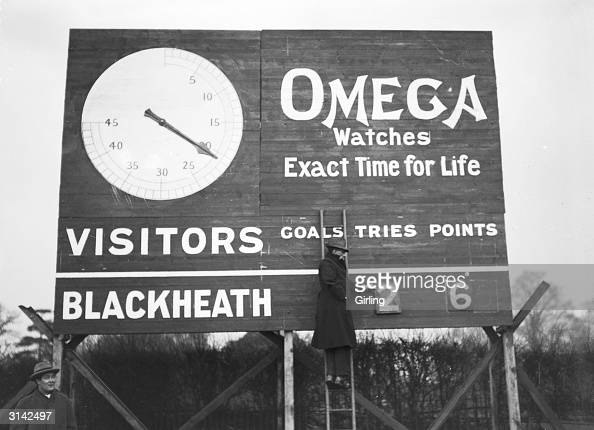 Updating the Omega scoreboard during the match between Blackheath and the Army at Blackheath rugby ground London