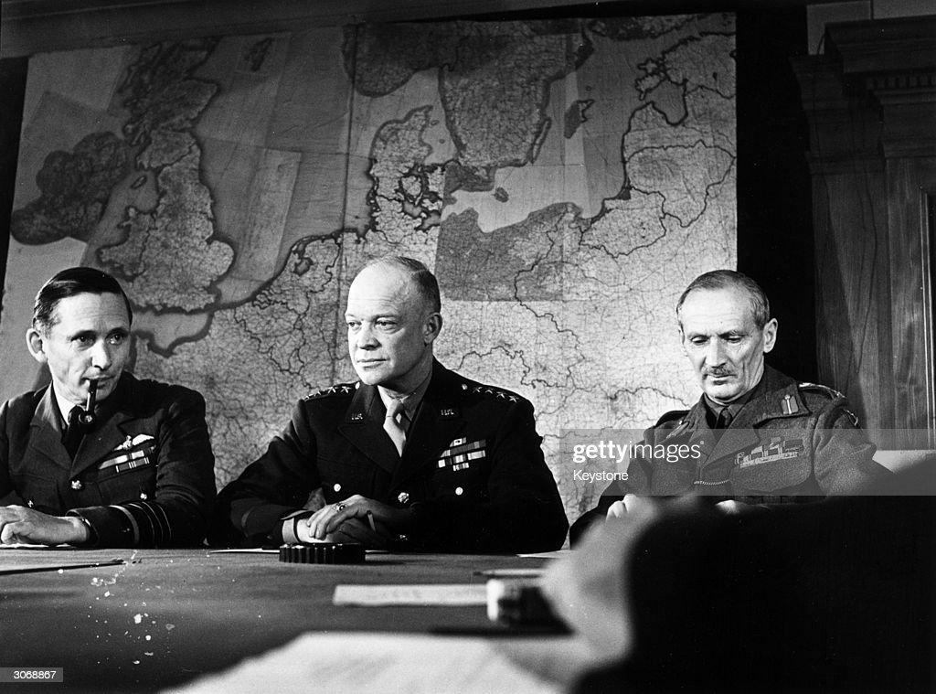 From left to right Air Chief Marshall Tedder General Eisenhower and Field Marshal Montgomery the Supreme Command of the Allied Expedition Force...