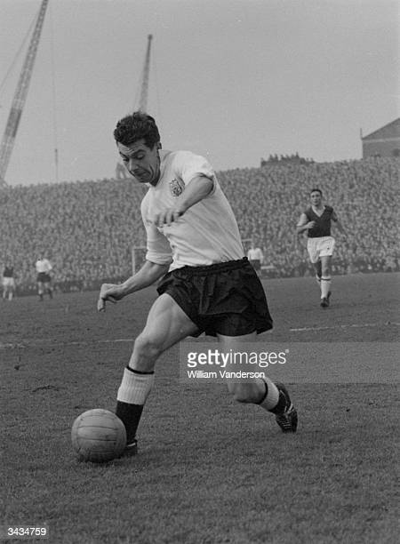 England footballer and Captain of Fulham Football Club Johnny Haynes during a match against West Ham
